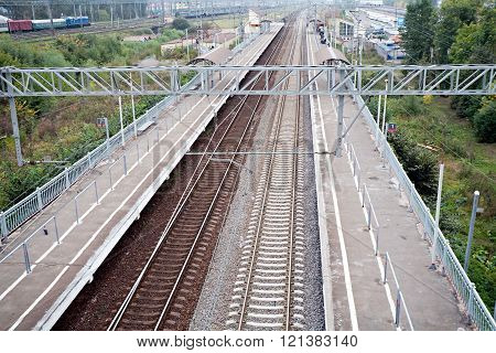 railway station platform and rails top perspective view