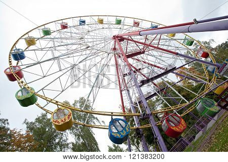 big ferris wheel diagonal view on park and sky background