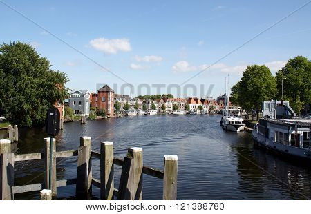 Haarlem. May-15-2014..Wooden mooring posts for boats and view over the