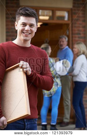 Parents Helping Adult Son To Move Into Home