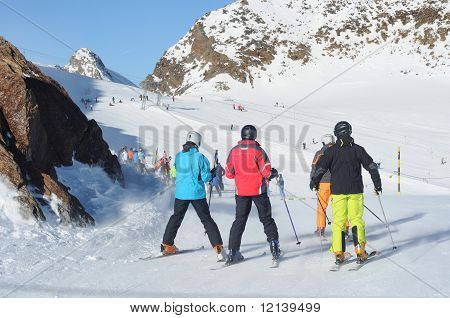 People Skiing In European Alps.