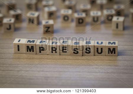 Impressum Written In Wooden Cubes