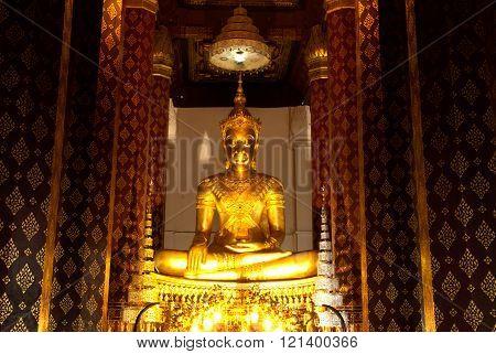 AYUTTHAYA,THAILAND-FEBRUARY 10,2010 : Phra Phuttha Nimit Wichitmara Moli Sri Sanphet Boromatrailokanat that in a royal regalia -clad, about six feet high Buddha statue in the Ubosot , at Wat Na Phra Meru . Located in Ayutthaya Historical park of Thailand,