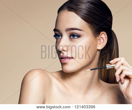 Young pretty woman with professional make-up