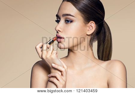Young woman with lipstick