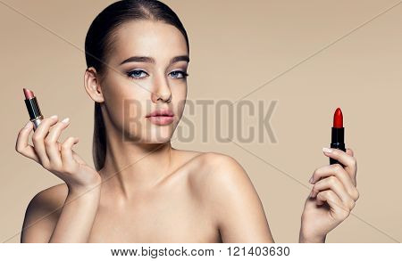 Beautiful young woman with lipstick