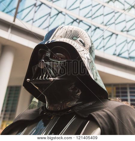 MILAN ITALY - MARCH 5: Darth Vader character of 501st Legion official costuming organization takes part in the Star Wars Parade wearing perfectly accurate costumes on MARCH 5 2016 in Milan.