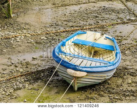 Fishing Boat In A Harbour During Outflow