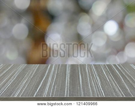 Empty Wooden Table With White Bokeh Blur Background