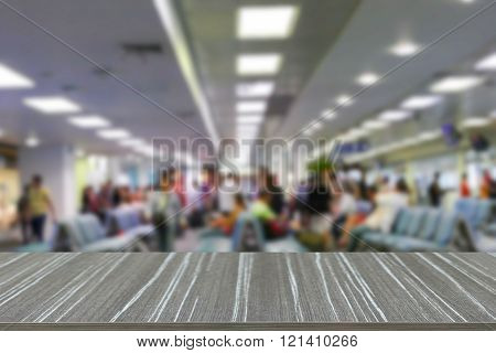 Empty Wooden Table With Passenger At The Airport Blur Background