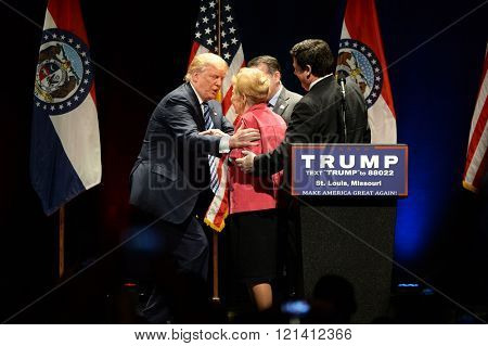 Saint Louis, MO, USA - March 11, 2016: Donald Trump salutes Phyllis Schlafly at the Peabody Opera House in Downtown Saint Louis