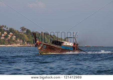 Kho Phi Phi, Thailand - August 2, 2010: Longboat at bay of Phi Phi island Krabi province Thailand