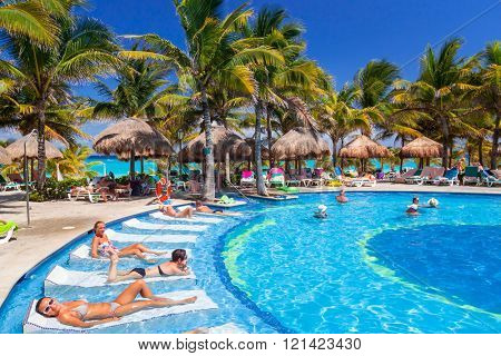 PLAYA DEL CARMEN, MEXICO - JULY 20, 2011: Scenery of luxury swimming pool at RIU Yucatan Hotel in Playa del Carmen. RIU Hotels & Resorts has more than 100 hotels in 19 countries.