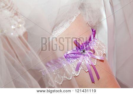 Bride's garter on the leg slim. Lace wedding garter. Air wedding. Wedding accessory for the bride.  ** Note: Shallow depth of field