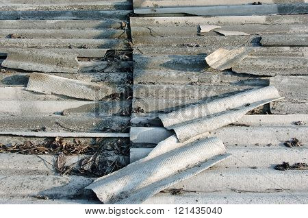 Asbestos roof background. Old grey roof tiles