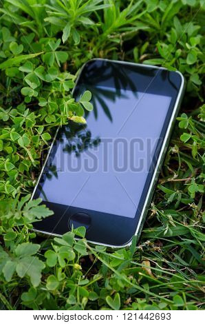 Smartphone Lying On The Grass