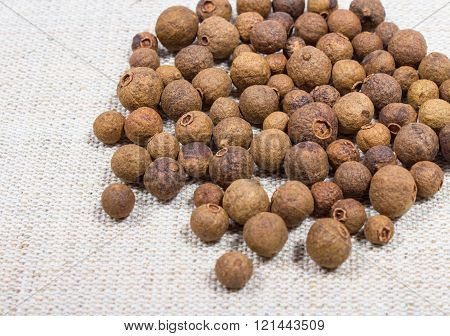 Grains Of Allspice On A Canvas
