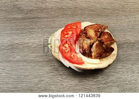 Greek Souvlaki With Pita Bread And Vegetables Close-up On The Table. Pork Table
