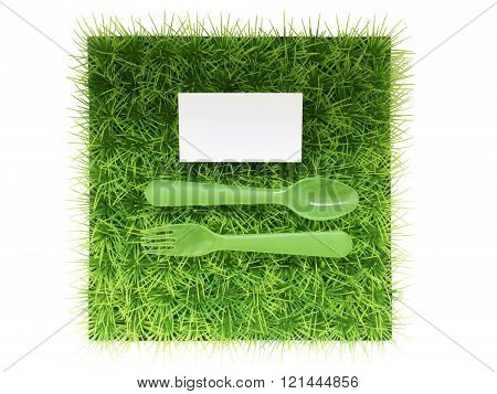 Plastic Fork And Spoon On Green Grass , Space For Text