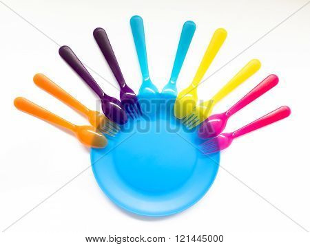 Interesting Coloured Plastic Tableware On A White Background, On A Picnic And Children's Parties