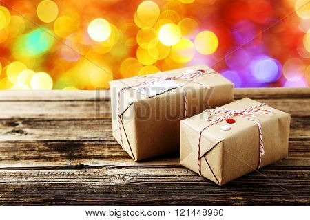 Beautiful Gift Boxes On Brown Wooden Background