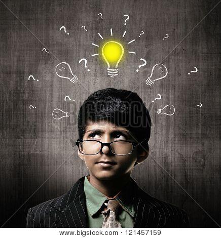 Genius Little Boy Wearing Glasses, Thinking Idea Near Chalkboard
