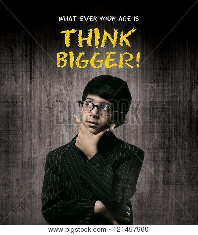 Think Bigger. Genius Little Boy Wearing Glasses, Thinking