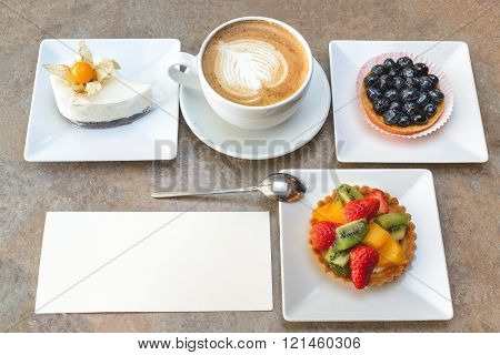 Fruit dessert and capuccino