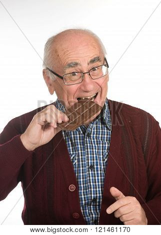 old man eating chocolate