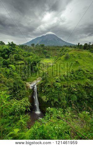 Kedung Kayang Waterfall and Mountain Merapi volcano. Java, Indonesia