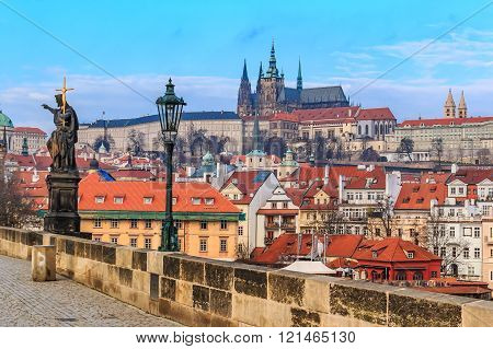 Prague, Czech Republic - January 16 2015: View onto Prague Castle from Charles Bridge (a.k.a. Stone Bridge Kamenny most Prague Bridge Prazhski most) over Vltava river in Prague Czech Republic after sunset