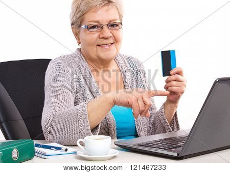 Elderly Senior Woman Holding Credit Card And Showing Laptop Screen, Paying Over Internet For Utility