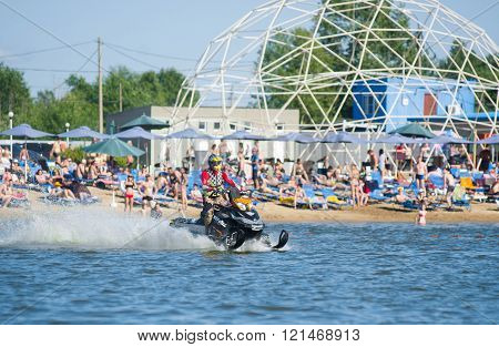 Man On Snowmobile Goes Fast On The Water In Summer