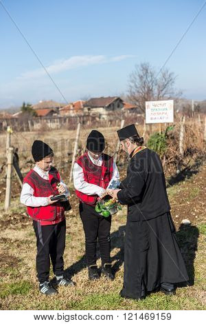 PERUSHTITSA BULGARIA - FEBRUARY 14 2015 - Recreating the ritual called Zariazvane in Perushtitsa Bulgaria. People dressed in traditional clothing dance and cut the vineyards for fruitful harvest.