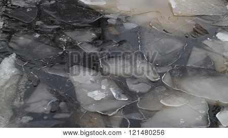blocks of ice on frozen river