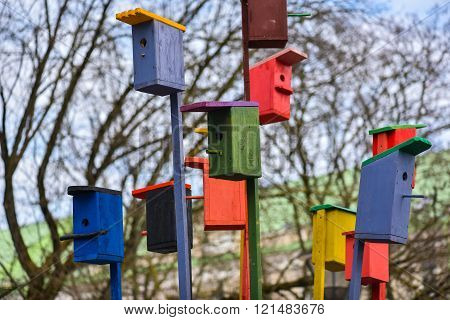 Painted nesting-boxes in the handicraft mart Kaziukas, Vilnius, Lithuania. Beautiful natural symbol of real estate and human life. poster