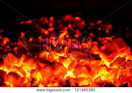 Hot coals on a black background