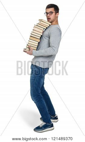 Young Man With A Pile Of Books In Hands