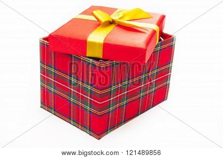 Red box with lid ajar on a white background