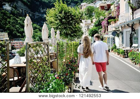 Young Couple Walking On Positano In A Sunny Day, Amalfi Coast, Italy