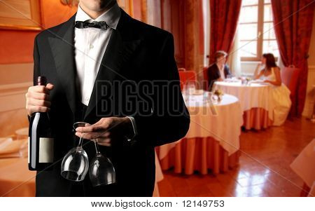 closeup of a waiter with bottle of wine and glass