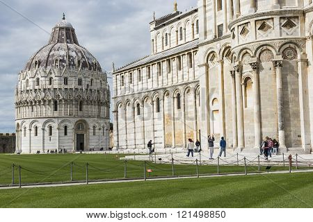 Piza, Italy - 10 March, 2016: View Of Leaning Tower And The Basilica, Piazza Dei Miracoli, Pisa, Ita