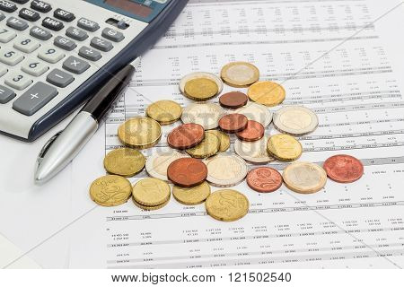 Euro Coins, Pen And Calculator Fragment On The Data Table