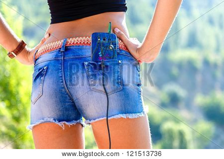 Beautiful Woman Buttocks In Jeans Shorts With The Phone In Pocket