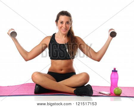 Happy young woman with her fitness equipment