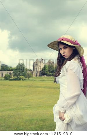 victorian woman with manor house