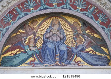 PISA, ITALY - JUNE 06, 2015: A colourful mosaic by Giuseppe Modena da Lucca, of the Virgin Mary, above the middle door of Cathedral in Pisa, Italy. Unesco World Heritage Site, on June 06, 2015