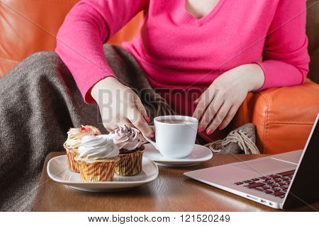 Woman Drink Tea And Eat Sweets