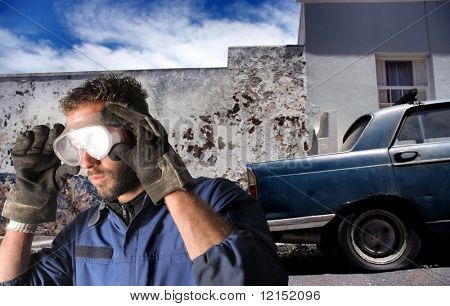 auto mechanic and old vintage car