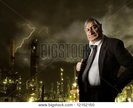 Portrait of nasty businessman on industrial background
